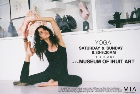 Moksha yoga instructor in front of the contemporary inuit art case.