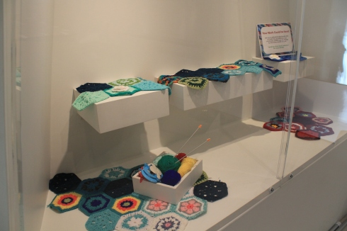 Special community exhibition case be prepared for visitor contributions as a part of Worldwide Knit in Public Day celebrations.